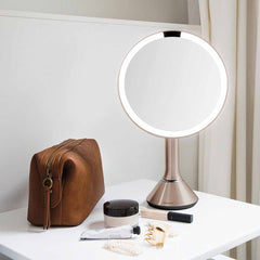 sensor mirror with touch-control brightness - rose gold finish - lifestyle with cosmetics