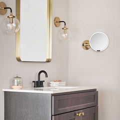 hard-wired wall mount sensor mirror - brass finish - lifestyle on wall image