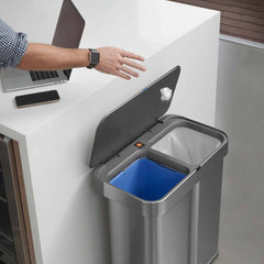 58L dual compartment rectangular sensor bin with voice and motion control - brushed stainless steel - lifestyle dual compartments throwing rubbish away