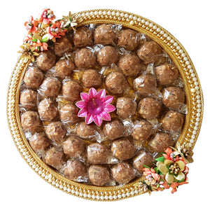 Gond Badam Laddoo on a pearl & Floral Platter