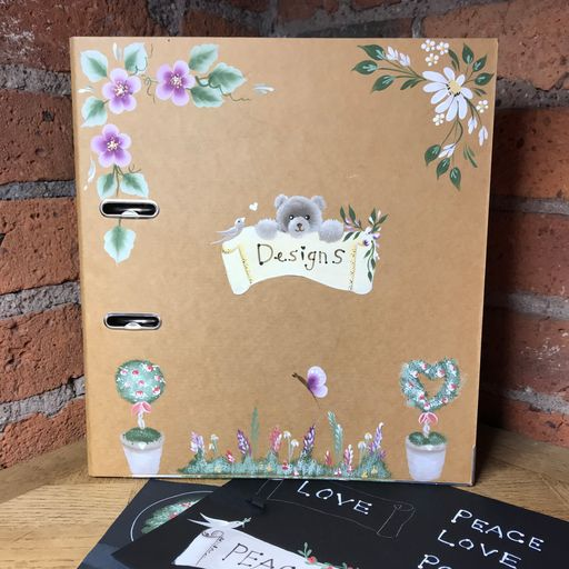 Kraft folder decorated and personalised with folk art designs - florals, topiary and teddies