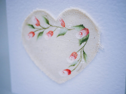 Folk Art Rosebuds painted on to a fabric heart to create a unique greetings card
