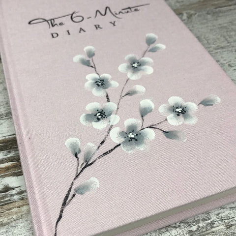 6 minute journal decorated with Oriental blossom flowers