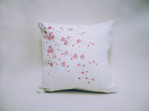 Plain white cushion cover decorated with a handpainted oriental blossom design from You Can Folk It