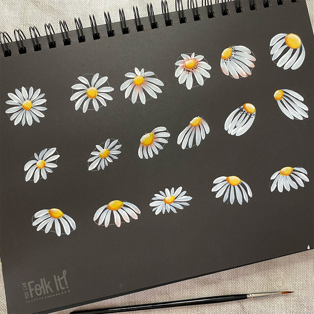 Painted daisy journal and paintbrush