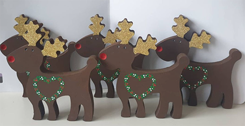 Five hand painted freestanding reindeer with red noses