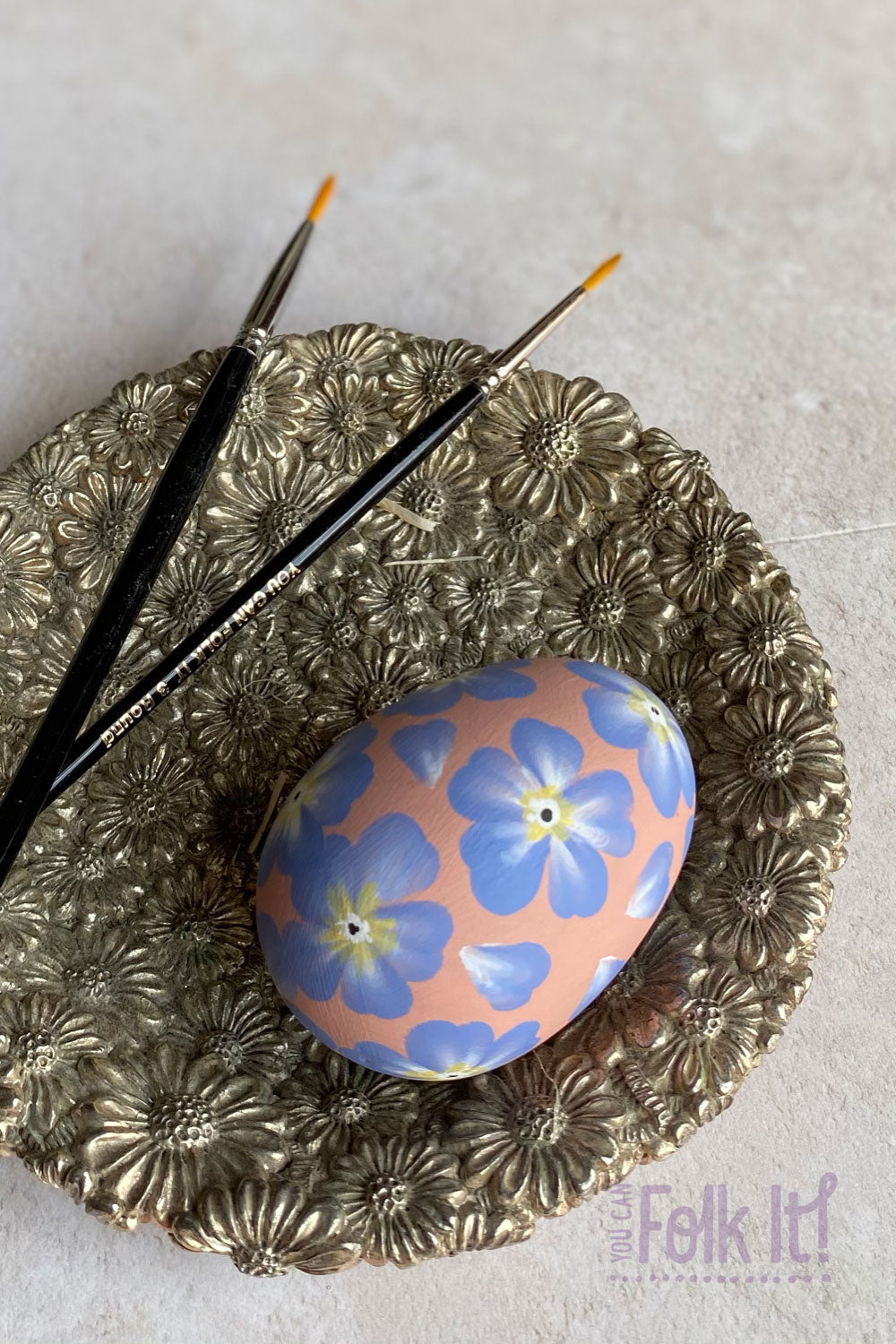 Ceramic egg hand painted with forget me not style flowers using the blossom painting tutorial from You Can Folk It's Folk Art masterclass for Intermediate painters