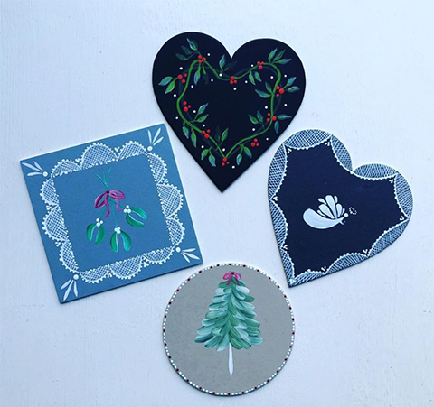 Christmas designs painted on to a variety of mount board shapes