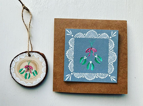 Mistletoe design hand painted on to a card and wood slice