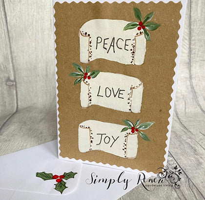 Brown kraft card decorated with handpainted scrolls from our Folk Art Masterclass for beginner painters labeled 'Peace' 'Love' & 'Joy'