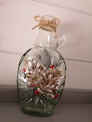 Glass jar hand painted with a festive fur cone design