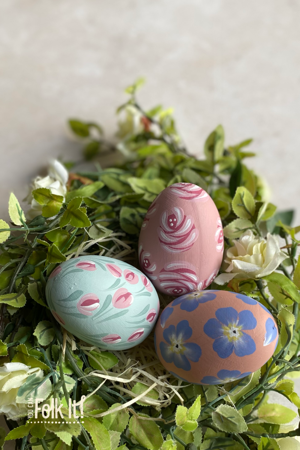 A trio of easter eggs hand painted with designs from You Can Folk It