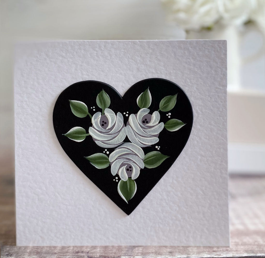 White folk art roses on a heart card - perfect for Valentines day