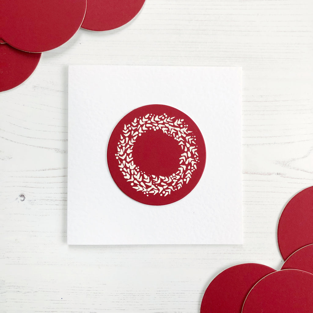 Red circle mount board painted with our Wreath design in white for a classic card