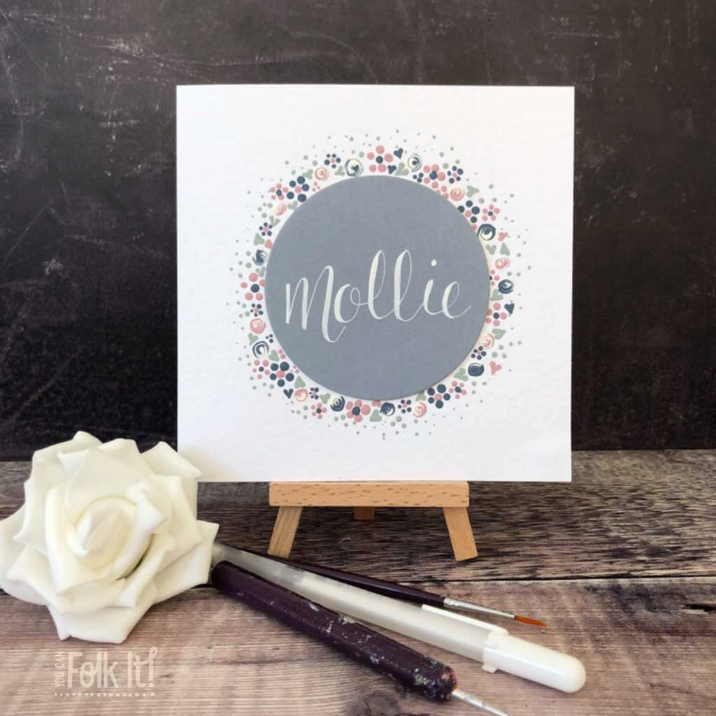 Dot design painted Folk It card with flowers around the outside of our mount board circle