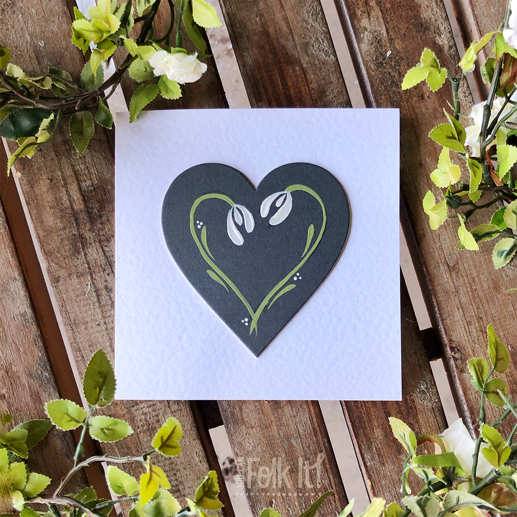 Snowdrop heart painted by You Can Folk It on a Charcoal Mountboard heart.
