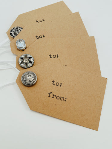 Set of 4 hand-cut and hand-stamped cardstock gift tags with silver tone button embellishments and white ribbon Size 4.25