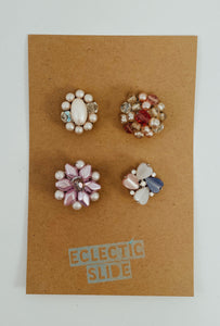 "Set of 4 vintage earrings paired with industrial strength magnets. Color palette: pinks and pearls. Size approx 1"" each"
