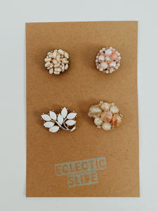 "Set of 4 vintage earrings paired with industrial strength magnets. Color palette: pinks and whites. Size approx 1"" each"