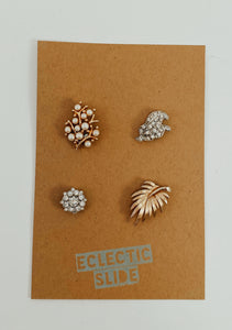 "Set of 4 vintage earrings paired with industrial strength magnets. Color palette: gold/silver tone flowers. Size approx 1"" each"
