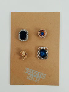 "Set of 4 vintage earrings paired with industrial strength magnets. Color palette: gold tone and sapphire blues. Size approx 1"" each"
