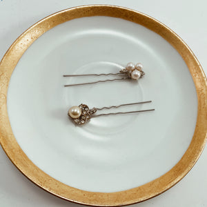 "Pearl beaded earrings paired with sturdy silver tone hair pins. Size 2.5"" in length"