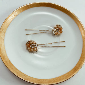 "Blush beaded earrings paired with sturdy gold tone hair pins. Size 2.75"" in length"