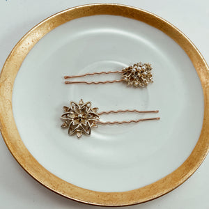 "Coordinating gold tone and pearl earrings paired with sturdy rose gold tone hair pins. Size 2.5"" in length"