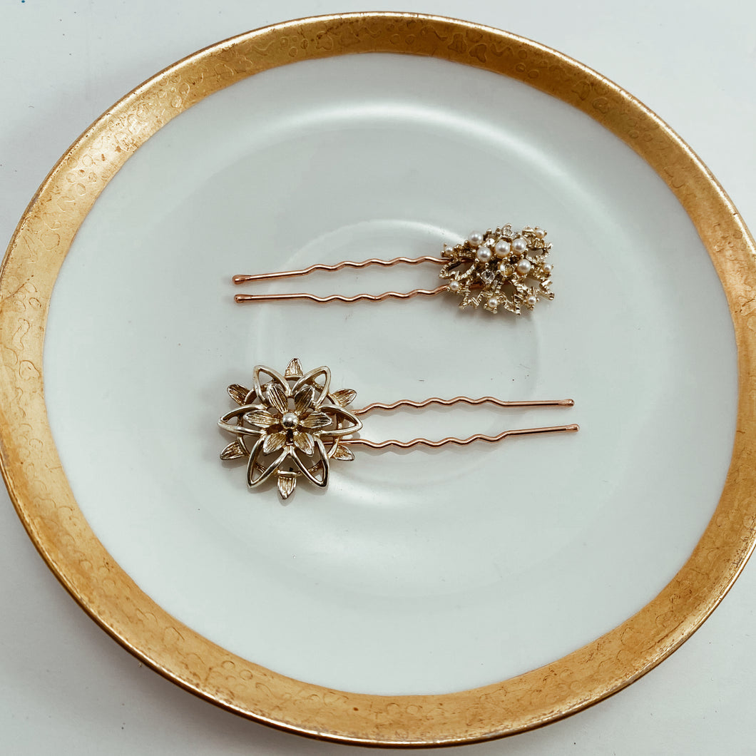 Coordinating gold tone and pearl earrings paired with sturdy rose gold tone hair pins. Size 2.5