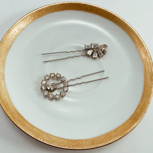 "Coordinating rhinestone earrings paired with sturdy silver tone hair pins. Size 2.5"" in length"