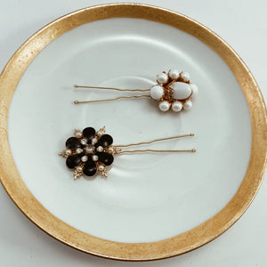 "Coordinating rhinestone and beaded earrings paired with sturdy gold tone hair pins. Size 2.75"" in length"