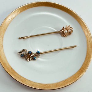 "Coordinating rhinestone and pearl earrings paired with salon quality gold tone bobby pins. Size 3.5"" in length"