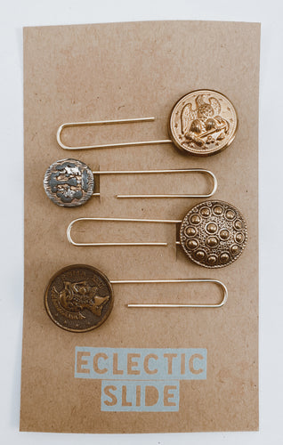 Assorted gold tone vintage buttons made useful again as paper clips. Set of 4 gold tone clips per package. Size approx. 2