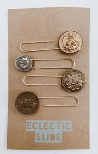 "Assorted gold tone vintage buttons made useful again as paper clips. Set of 4 gold tone clips per package. Size approx. 2"" each."