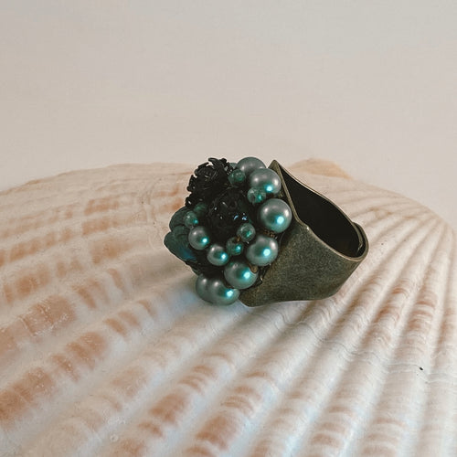 Adjustable size bronze ring, adorned with a beaded vintage earring in all shades of green