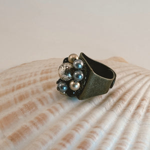 Adjustable size bronze ring, adorned with a beaded vintage earring in shades of gold, black and gray