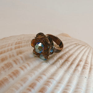 Adjustable size copper ring, adorned with a beaded vintage earring in shades of amber