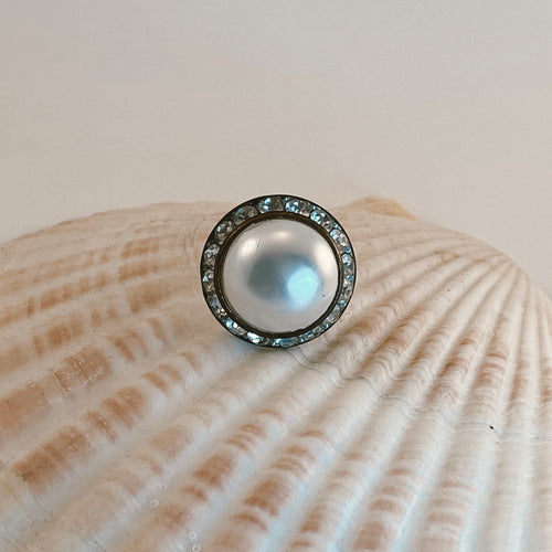 Adjustable size gold tone ring, adorned with a vintage pearl earring with rhinestone accents