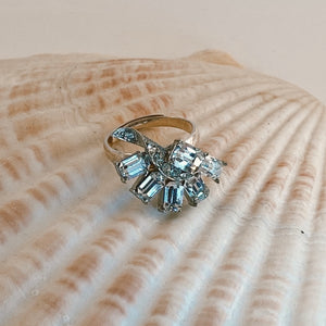 Adjustable size .925 Sterling Silver ring, adorned with a vintage earring with rhinestone accents