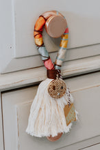"Load image into Gallery viewer, Cotton rope, hand wrapped with colorful threads, adorned with a unique, coordinating charm Size approx 3"" x 8"" - colors may vary from picture"