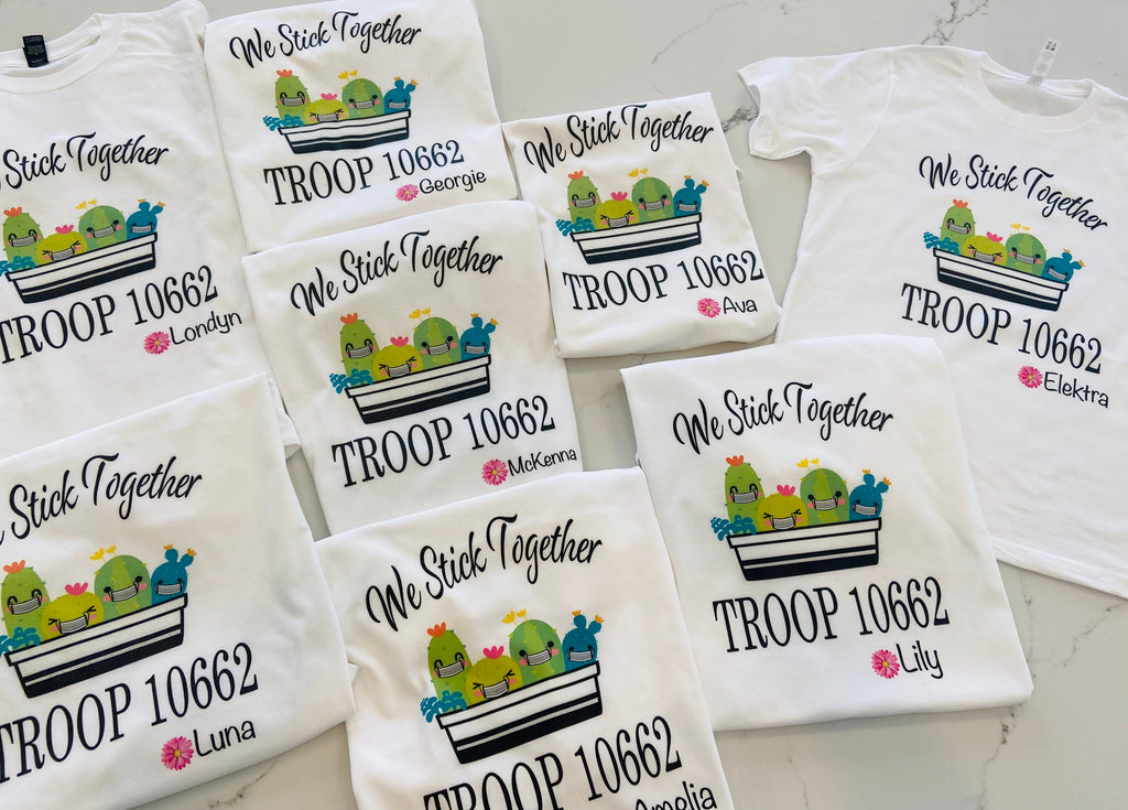 The cutest colorful Girl Scout Tees ! Personalized with troop number , masks or no masks and name   Cactus can be with or without masks - please note in personalization section when you check out   We stick together tee with names and troop number personalized on each shirt