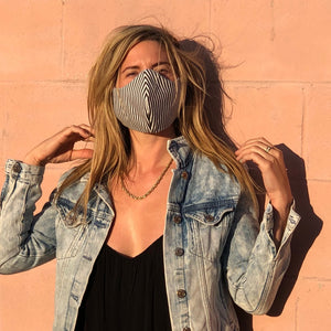 Woman wearing Barred Code reusable, reversible and washable face mask. Features integrated filter pocket. Made from three layers of 100% cotton. Designed and manufactured by Mr. Pink's based in California. Made in USA.