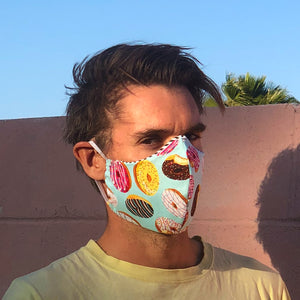 Man wearing Donut Go Out! reusable, reversible and washable face mask. Features integrated filter pocket. Made from three layers of 100% cotton. Designed and manufactured by Mr. Pink's based in California. Made in USA.