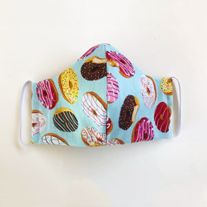 Detail of Donut Go Out! reusable, reversible and washable face mask. Features integrated filter pocket. Made from three layers of 100% cotton. Designed and manufactured by Mr. Pink's based in California. Made in USA.