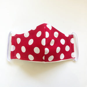 Front of Polkadot mask, a reusable, reversible and washable face mask. Features integrated filter pocket. Made from three layers of 100% cotton. Designed and manufactured by Mr. Pink's based in California. Made in USA.