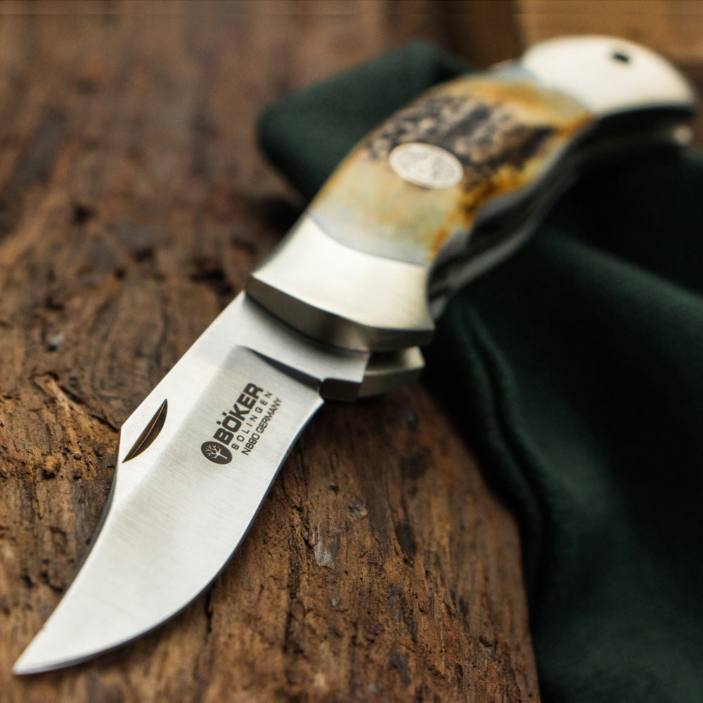 Boker Junior Scout Stag Folding Knife Open on Log