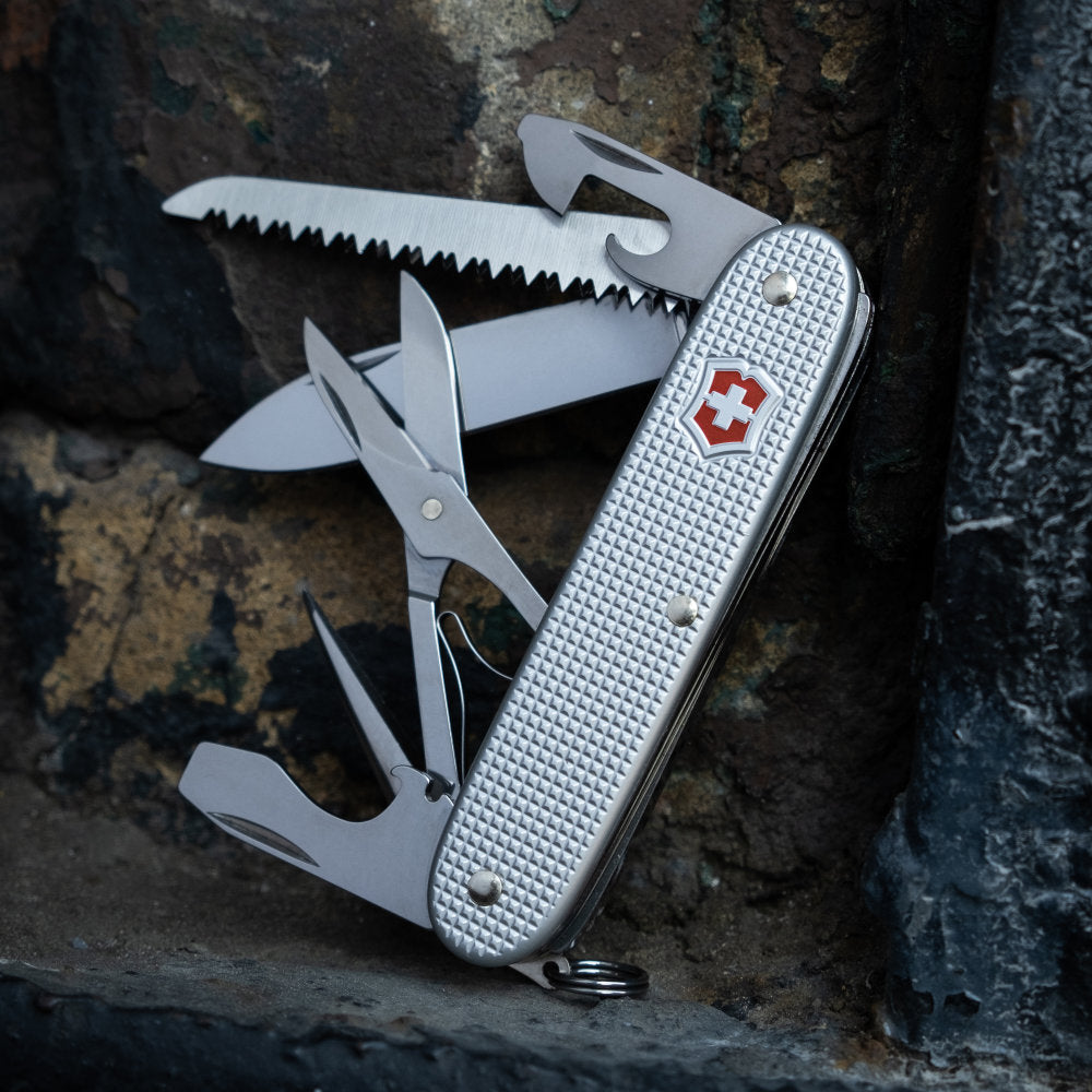 Farmer X Swiss Army Knife by Victorinox On a Rock Ledge