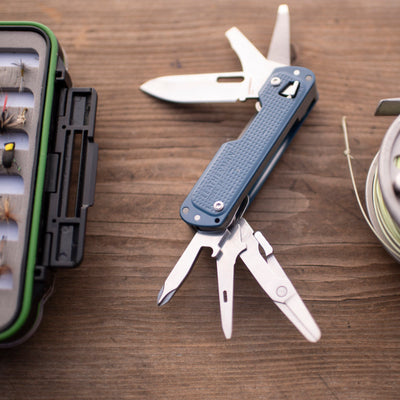 Leatherman FREE T4 Multi-tool Navy Fanned with Fly Fishing Gear