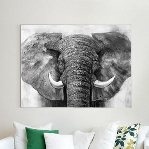 The canvas wall art of an elephant with a white couch | Dekor Company