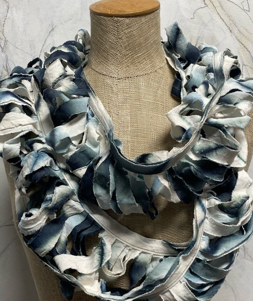 Amy Nguyen Ladder Scarf     True to the Japanese Shibori techniques that Amy Nguyen employs, the simplicity of this scarf is in direct proportion to the sophistication it took to make it.  Enjoy this beautiful little gem made of silk & linen.